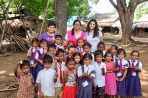 Saniya surrounded by children