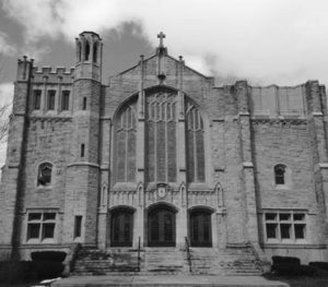 Black and white picture of a brick church