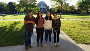 4 students standing on SU quad