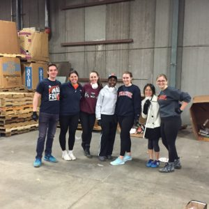 7 students volunteering in warehouse