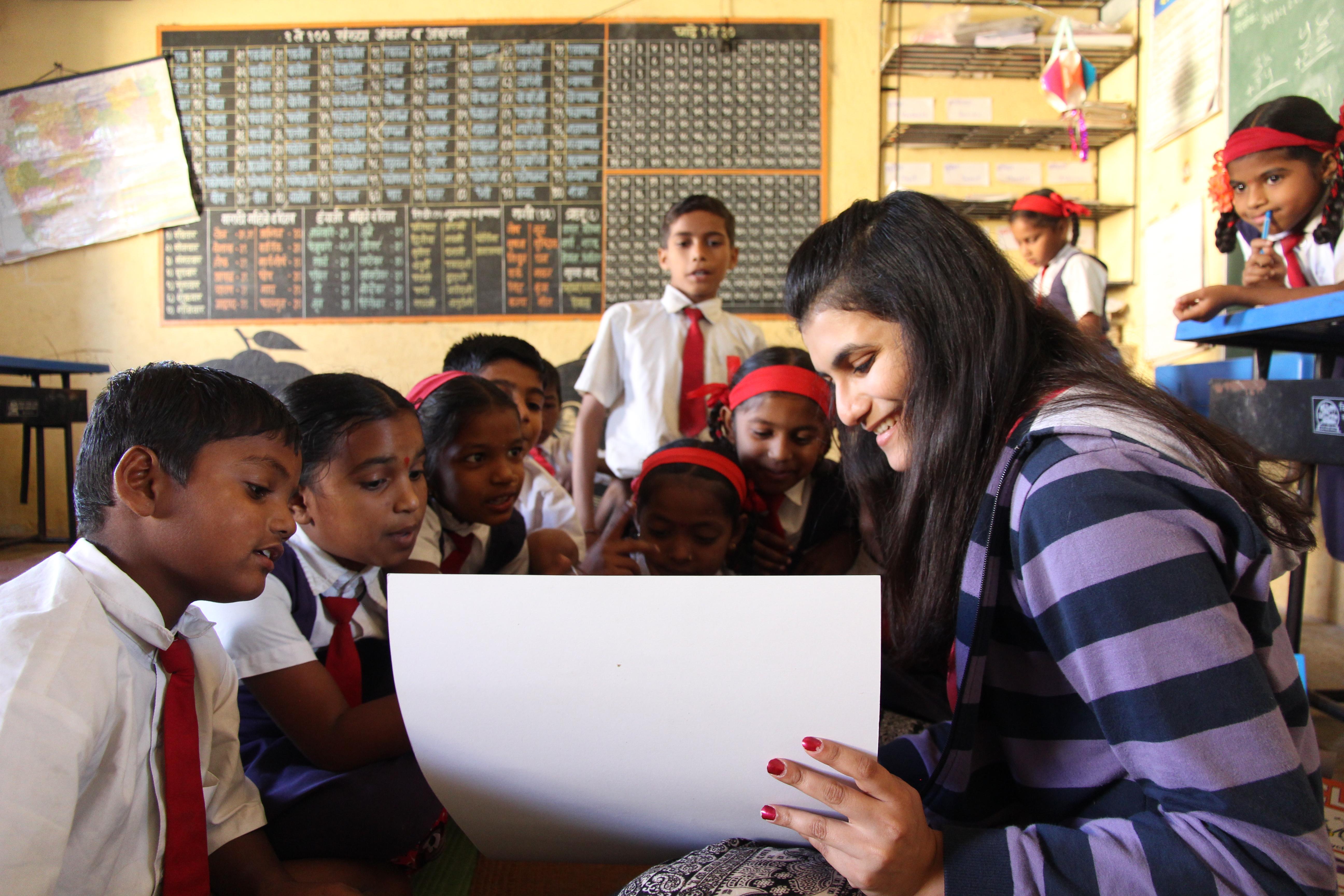 Saniya reading to group of children