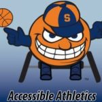 Otto the orange in a wheel chair with basketball