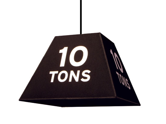 "Huge weight hanging with ""10 tons"" marked on it"