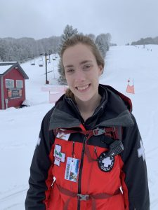 Julia-Cleo-Fisher in her ski patrol uniform on the slopes