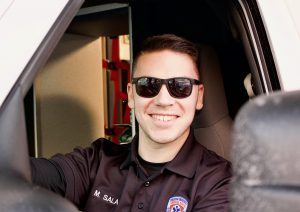 Matthew-Sala in SUA uniform sitting in ambulance