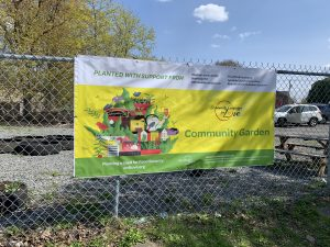 community-garden-poster hanging on a chain link fence