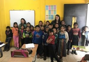Kara Foley in a classroom with children