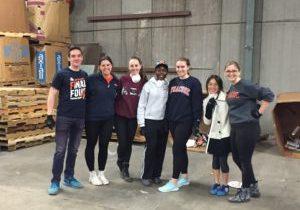 7 students volunteering in warehouse