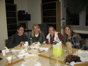 students around table in the library
