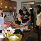Honors students help in the Catholic Charities Refugee Resettlement kitchen.