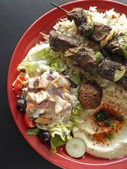 plate of hummus, kabob, salad