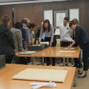 group looks at collections samples