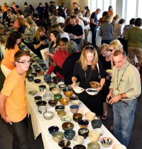 people selecting ceramic bowls