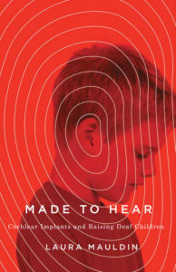 Image description: A book cover featuring a profile photograph of a young, white boy as he looks slightly downward. The picture is a saturated red color with white lines emanating from the boy's ear outward to the edge of the book, suggesting sound waves. Overlaid on that in white letters is the title of the book.