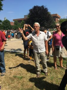 John Western on the quad with eclipse watchers