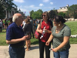 Sam Gorovitz, Cathryn Newton, and Nedda Sarshar enjoy the eclipse on the quad