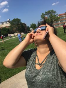 Nedda Sarshar looking at eclipse with cardboard glasses