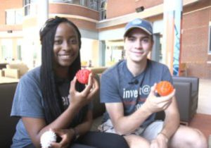 2 students holding round objects