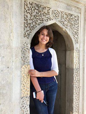 Giovanna Saccoccio posing under an archway