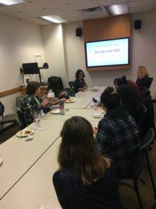 students sitting around seminar table with Kim van Alkemade