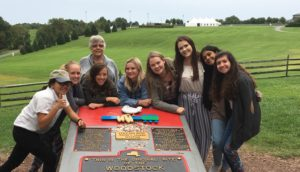 students and professor at Woodstock monument