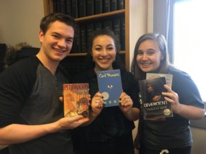 Students smiling and holding books
