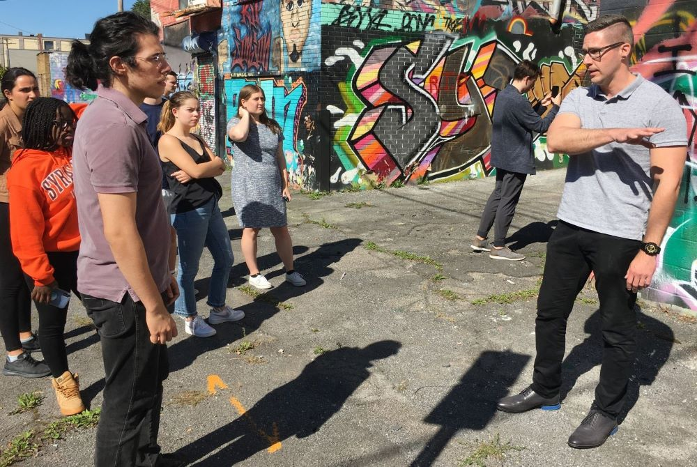 Tim VanBeveren, a Syracuse graffiti artist, talks to the Art in Life class class about art, gentrification and why he does art.