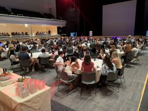 students gathered around tables