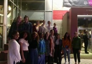 Group of students in front of the entrance to Syracuse Stage